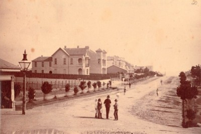 Ferdinand Reuss won a design competition to lay out the model suburb of nearby Annandale. His design was based on a grid pattern and very wide streets. This photograph of Johnston Street, Annandale, is dated c1880.